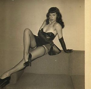 Betty Page with sexy stockings showing her body hustler vintage erotica