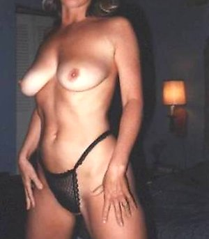 homemade vintage porn pics of a naked woman sitting on sofa